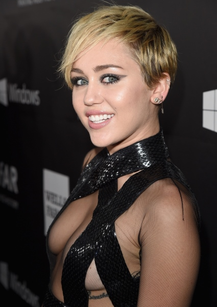 Miley Cyrus Has Been Hinting at Her Bi-Sexuality for Years; See the Photos! 3