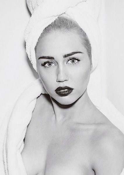 Miley Cyrus Shares Raunchiest Photos Yet, Sexting the Night Away (See!) 6