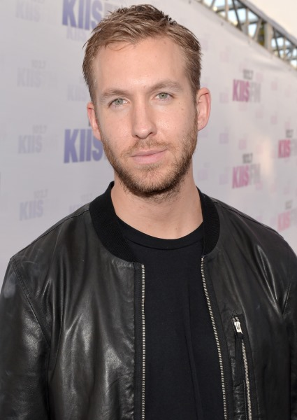 Calvin Harris, Mad as Hell at Paps, Clips a Wall in Luxury SUV (Watch!) 10