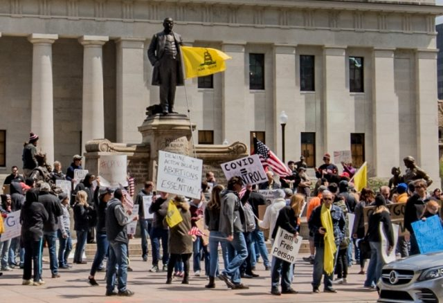 Protesters gather outside the Ohio statehouse to demonstrate against coronavirus restrictions. (Photo: