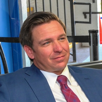 Florida Gov. Ron DeSantis has caused COVID-19 cases and deaths to skyrocket in his state. (Photo: Fla Govt.)