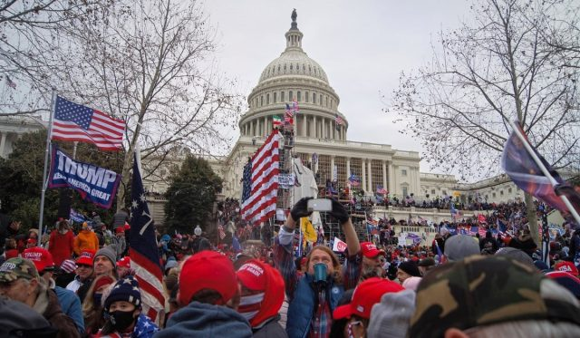 Rioters storm the Capitol. Many have military backgrounds, raising alarm a the Pentagon. (Photo: Tyler Merbler)