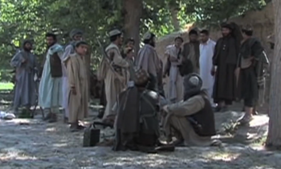 Taliban fighters pause during their 2021 offensive to take over Afghanistan. (Photo: Sayed Hasib Maududi, Roshan Noorzai for VOA)