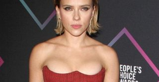 Scarlett Johansson</strong> must have spent one too many nights alone and bored in a hotel room. She apparently passed the time taking nude photos of herself with her camera phone. (Photo: Bang ShowBiz)